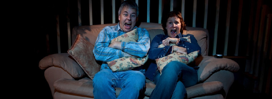 Couple on sofa screaming